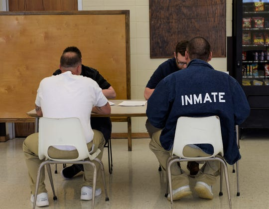 Inmates at Mike Durfee State Prison meet with potential employees at the prison's third job fair on Monday, April 29, 2019.