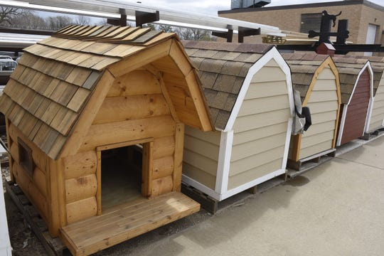 Inmates at the Mike Durfee State Prison use scrap materials from construction and welding classes to make dog houses that are donated to nonprofits around the state.