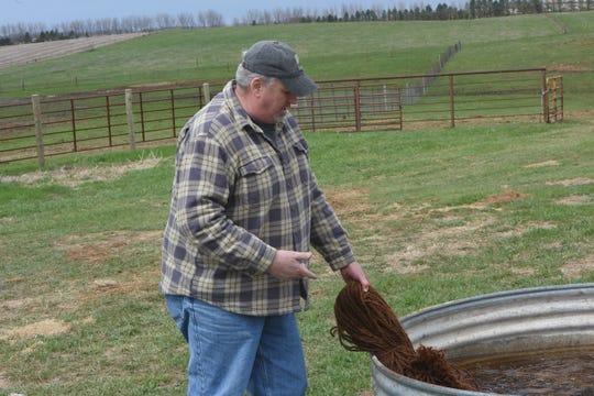 Troy Grovenburg examines some coconut fiber netting on April 26, 2019.