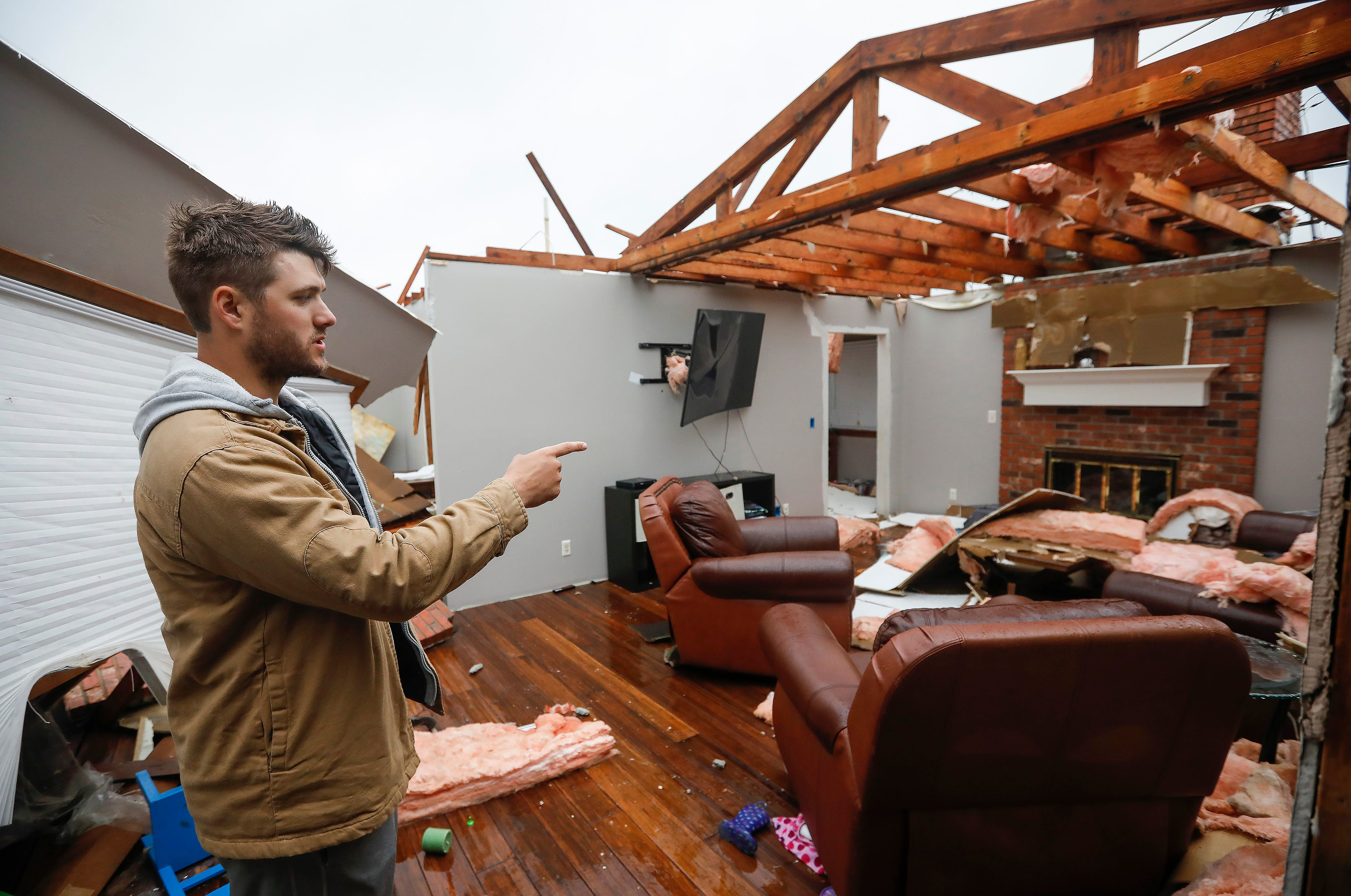 Denton Wilson walks through his home on Wednesday and talks about how he and his family took shelter during a likely tornado that hit Ozark on Tuesday, April 30, 2019.