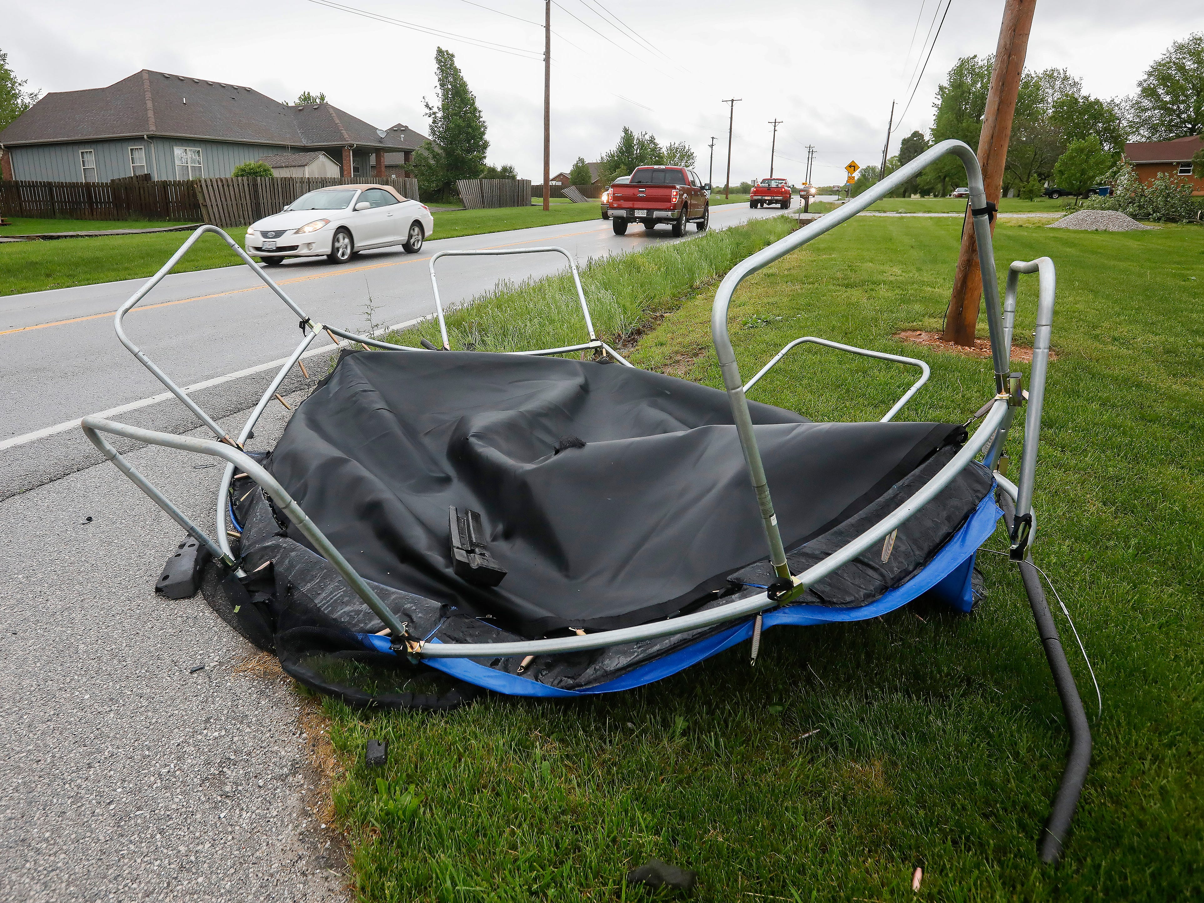 This tarp was blown onto Highway NN near the Waterford neighborhood by a likely tornado that moved through Ozark on Tuesday April 30, 2019.