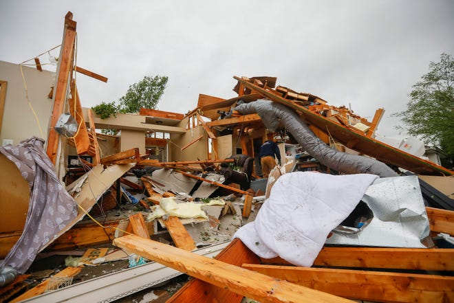 An EF-2-rated tornado with wind gusts of up to 134 mph hit the Waterford subdivision in Ozark on April 30, 2019.