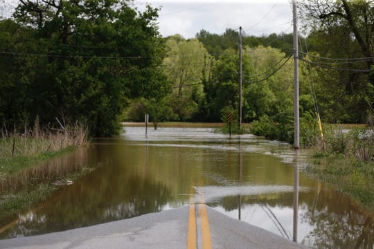 The flooded James River covers Kinser Road in east Springfield.