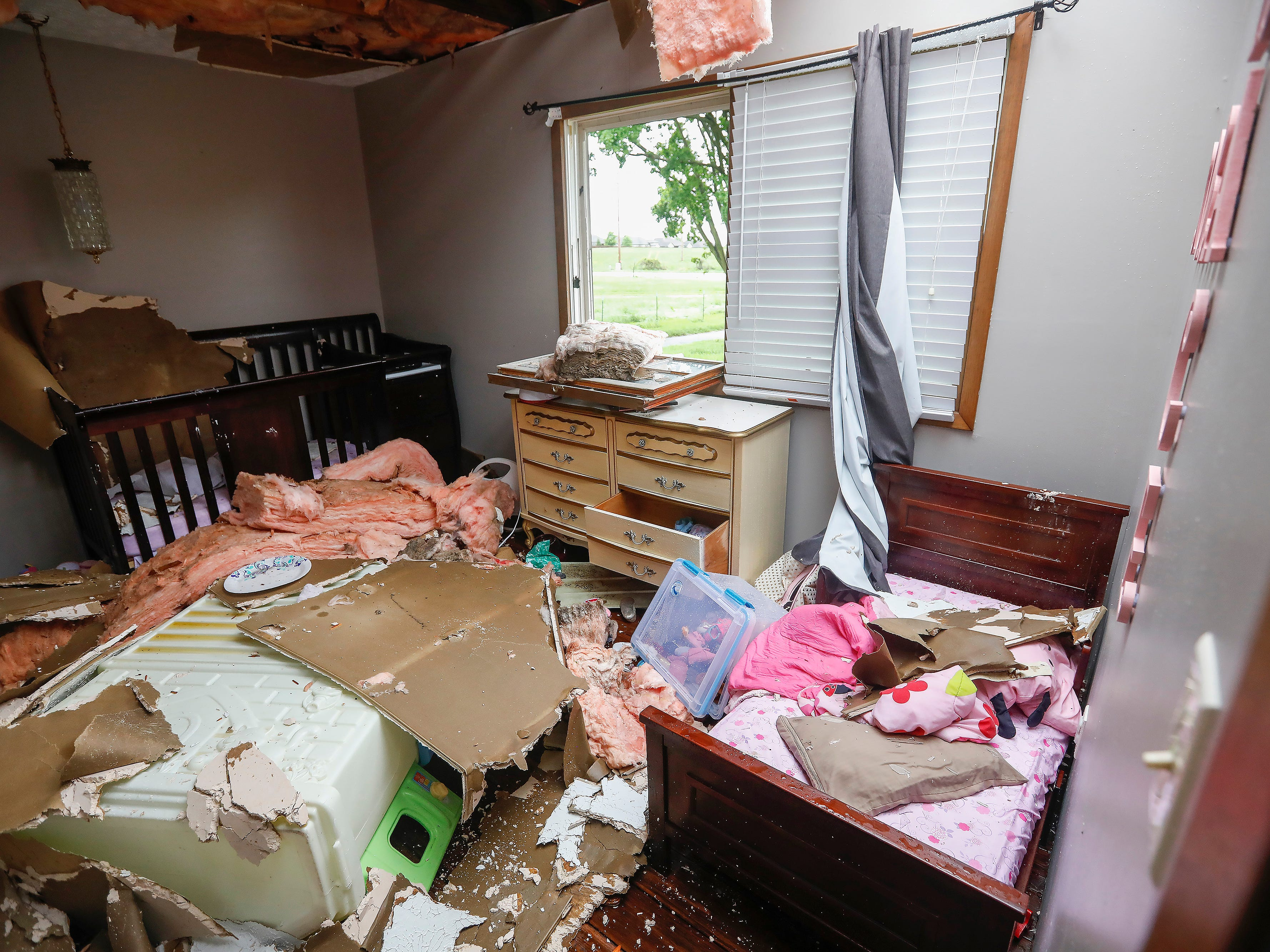The beds where two of Denton Wilson's children sleep is covered in debris on Wednesday. Wilson and his family took shelter in the bathroom during a likely tornado that hit Ozark on Tuesday, April 30, 2019.