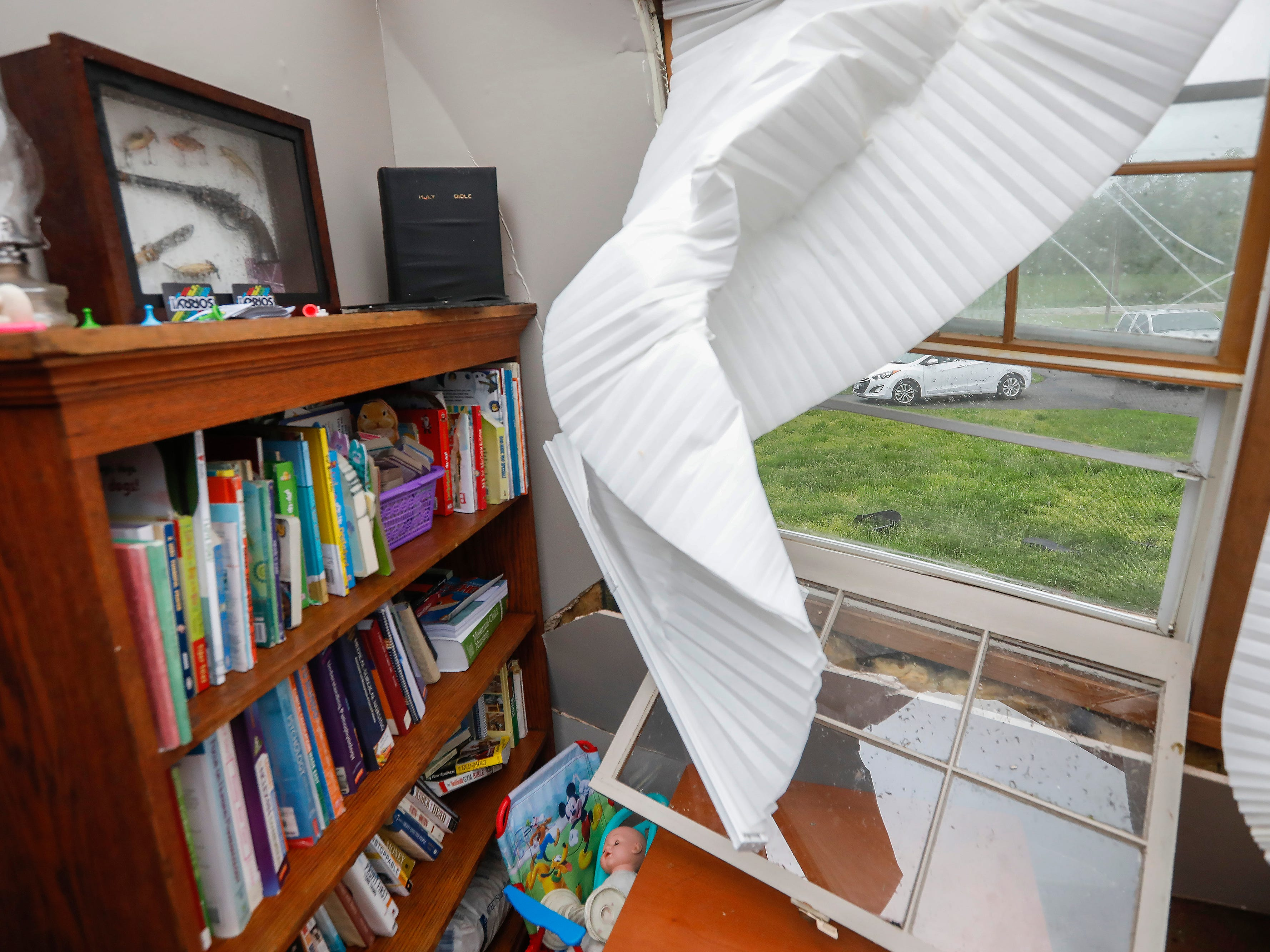 A Bible on top of a bookcase in Denton Wilson's home was untouched by a likely tornado that hit Ozark on Tuesday, April 30, 2019.