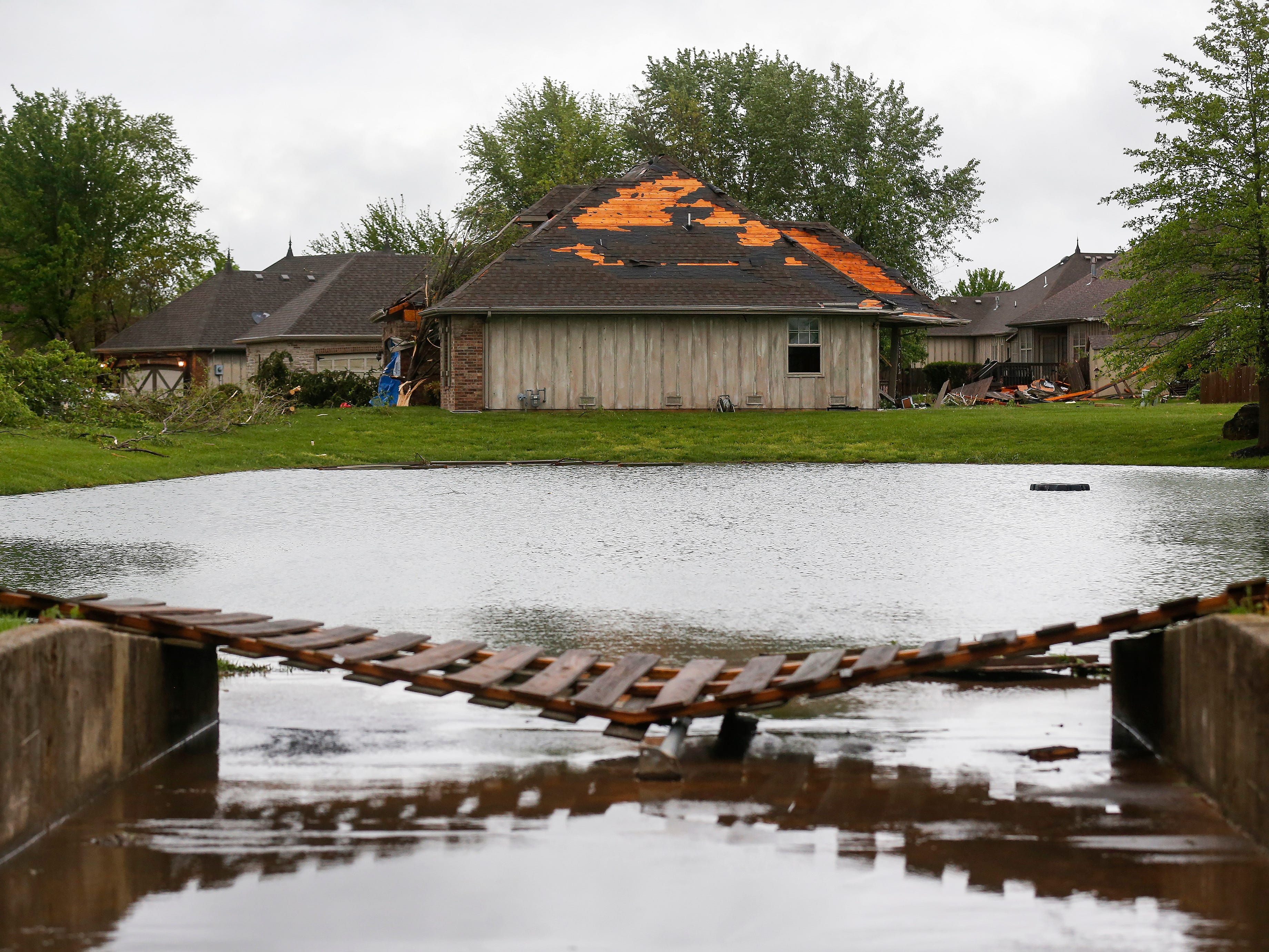 Homes and fences in the Waterford neighborhood were damaged by a likely tornado moved through the Ozark on Tuesday April 30, 2019.