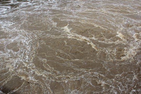 Water churns with dangerous currents below Lake Springfield Dam Wednesday.