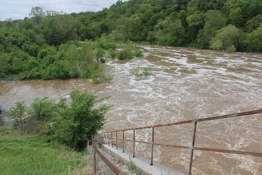 The James River spread far out of its banks Wednesday morning below Lake Springfield dam.