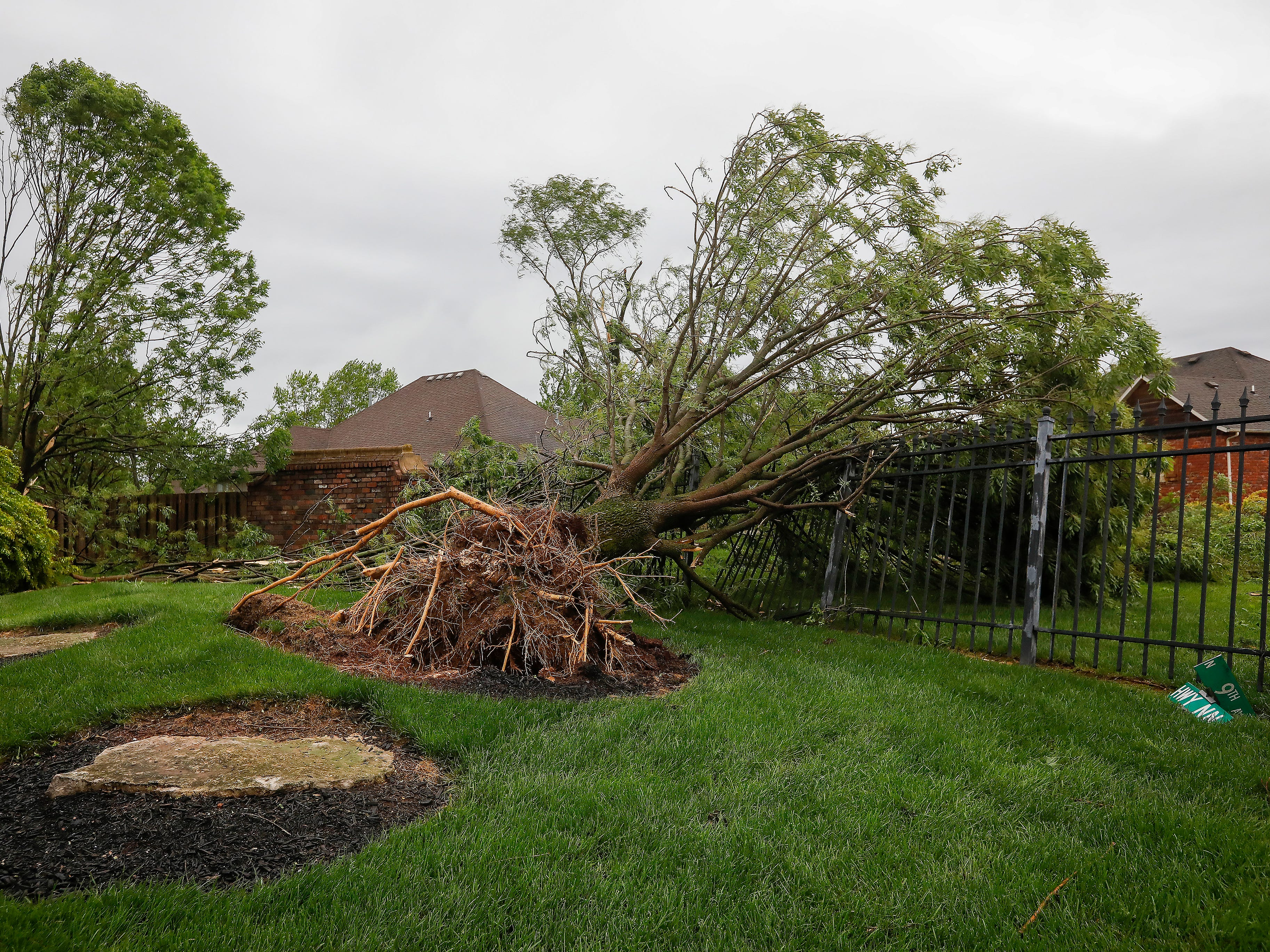 Homes and trees in the Waterford neighborhood were damaged by a likely tornado moved through the Ozark on Tuesday April 30, 2019.