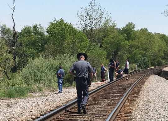 Authorities investigate the area where a man was struck and killed by a train Wednesday in Stuarts Draft.