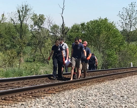 Rescue personnel carry the body of a man killed May 1, 2019, in Stuarts Draft after he was struck by a train.