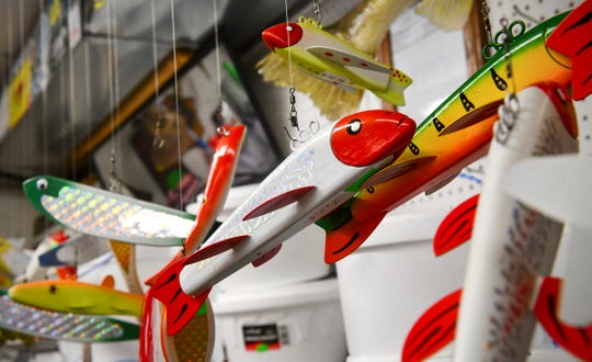 Brightly colored spearing decoys are on display at Stop  Light Bait in St. Cloud.