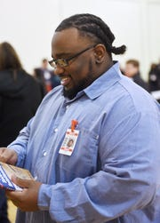 Robert Lee visits with staff at the Minnesota Correctional Facility-St. Cloud on Wednesday, May 1, following a release planning fair where inmates connected with community groups. Lee spoke at the event.