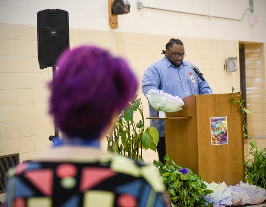 Robert Lee speaks about his barber training Wednesday, May 1, at the Minnesota Correctional Facility-St. Cloud while Transitions Program Coordinator Jacqueline Richards looks on.