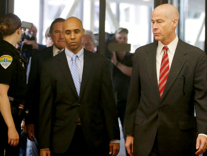 Former Minneapolis police officer Mohamed Noor walks through the skyway with his attorney Thomas Plunkett, right, on the way to court for the verdict Tuesday, April 30, in Minneapolis.