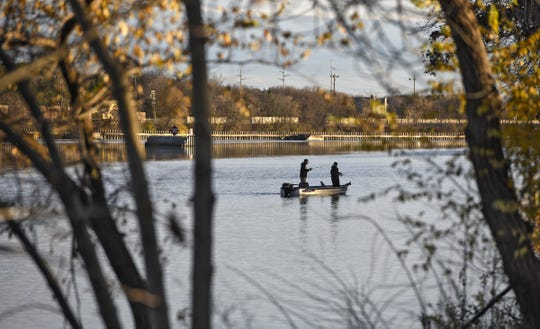 Anglers try their luck on the Mississippi River just above the Sartell dam in this 2017 file photo.