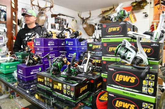 Stoplight Bait owner Aaron Kreller talks about about how busy his shop gets around the Minnesota fishing opener during an interview Tuesday, April 30, at the St. Cloud business.