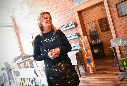 Jen Monroe talks about her business Wednesday, May 1, at  MMG² Workshop in downtown St. Cloud.
