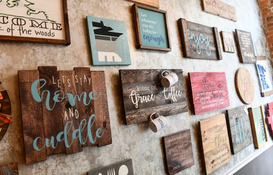 A display of many types of custom-made signs fills a wall Wednesday, May 1, at  MMG² Workshop in downtown St. Cloud.
