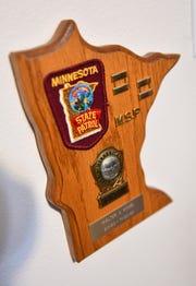 Memorabilia of Walt Kosel's service as a Minnesota State Patrol trooper is on display on his home in Waite Park.