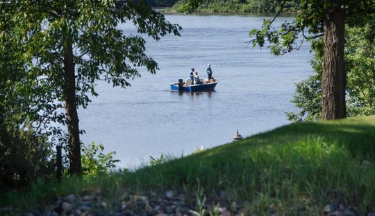 Fishermen try their luck near the shoreline of homes along the Mississippi River in 2018.  Dave Schwarz, dschwarz@stcloudtimes.comFishermen try their luck near the shoreline of homes along the Mississippi River in 2018.