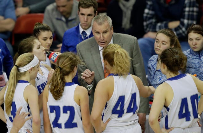 Amherst coach Gregg Jensen leads his players against Marshall during their 2018 Division 3 championship game at the WIAA state girls basketball tournament at the Resch Center in Ashwaubenon.