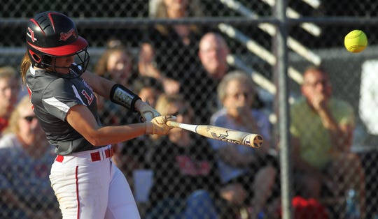 Leon junior Regan Hermeling belts a hit as Lincoln beat Leon 11-1 in six innings during a District 2-8A semifinal softball game on Tuesday, April 30, 2019.
