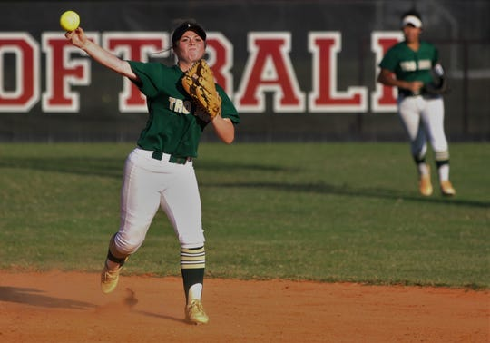 Lincoln senior second baseman Shelby Sloan throws to first for an out as Lincoln beat Leon 11-1 in six innings during a District 2-8A semifinal softball game on Tuesday, April 30, 2019.