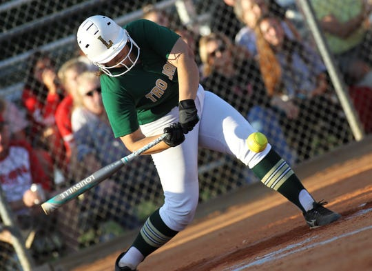 Lincoln junior Macy Kelley swings at a pitch and laces an RBI hit as Lincoln beat Leon 11-1 in six innings during a District 2-8A semifinal softball game on Tuesday, April 30, 2019.