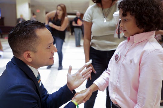 Isaac Diaz, 7, of Tampa, meets Rep. Carlos Guillermo-Smith, D-Orlando, as Diaz, his mother and nearly a hundred others chant in protest of the sanctuary cities bill and others in the Capitol rotunda Wednesday, May 1, 2019.