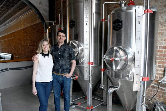 Gallagher and Nicole Dempsey, co-owners of Southern Philosophy Brewing, pose for a photo in the tasting room as part of a profile in Bainbridge Living Magazine that published this week.