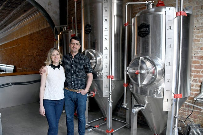 Gallagher and Nicole Dempsey, co-owners of Southern Philosophy Brewing, pose for a photo in the tasting room as part of a profile in Bainbridge Living Magazine after its opening in 2019.