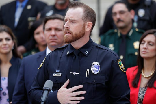 Jacksonville Sheriff's Officer Matt Herrera, handler of Fang, a K9 who was killed in the line of duty, speaks during a news conference held before Gov. Ron DeSantis signed a bill creating harsher penalties for criminals who harm law enforcement animals in the Capitol courtyard Wednesday, May 1, 2019.