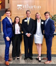 The Yeti Investors and their team adviser, from left to right, Hayden McDaniel, Madelyn Stout,  David Roberts, Madeleine Roberts and Collin Roberts during the Knowledge@Wharton High School Investment Competition in March.