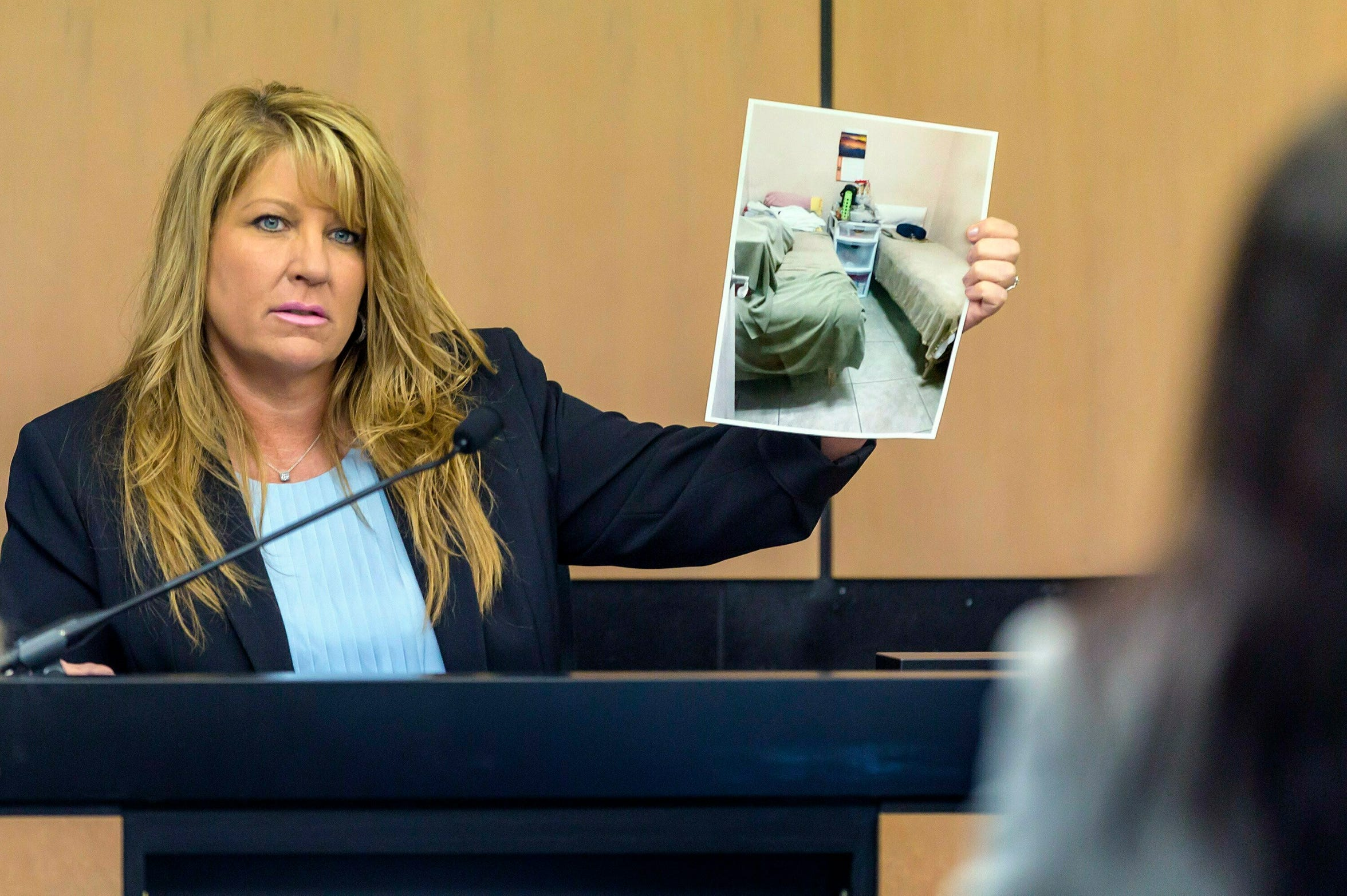 Karen Herzog, a Florida Department of Health inspector, shows a photo she took of beds in a room during her inspection of the Orchids of Asia Day Spa, during a motion hearing in the Kraft prostitution solicitation case Tuesday, April 30, 2019, in West Palm Beach. The Florida health inspector testified Tuesday that she saw possible evidence of human trafficking at the massage parlor where police say New England Patriots owner Robert Kraft later was accused of paying for sex, leading her to fear for her safety.