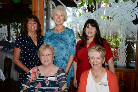 Martin County Guild members, from left, seated, Pat Garrett and Mimi Warren, with Pam Gardner, standing, Joyce Powell and Grace Martin of Center State Bank at the  Martin County Donor Appreciation Luncheon in Jensen Beach.