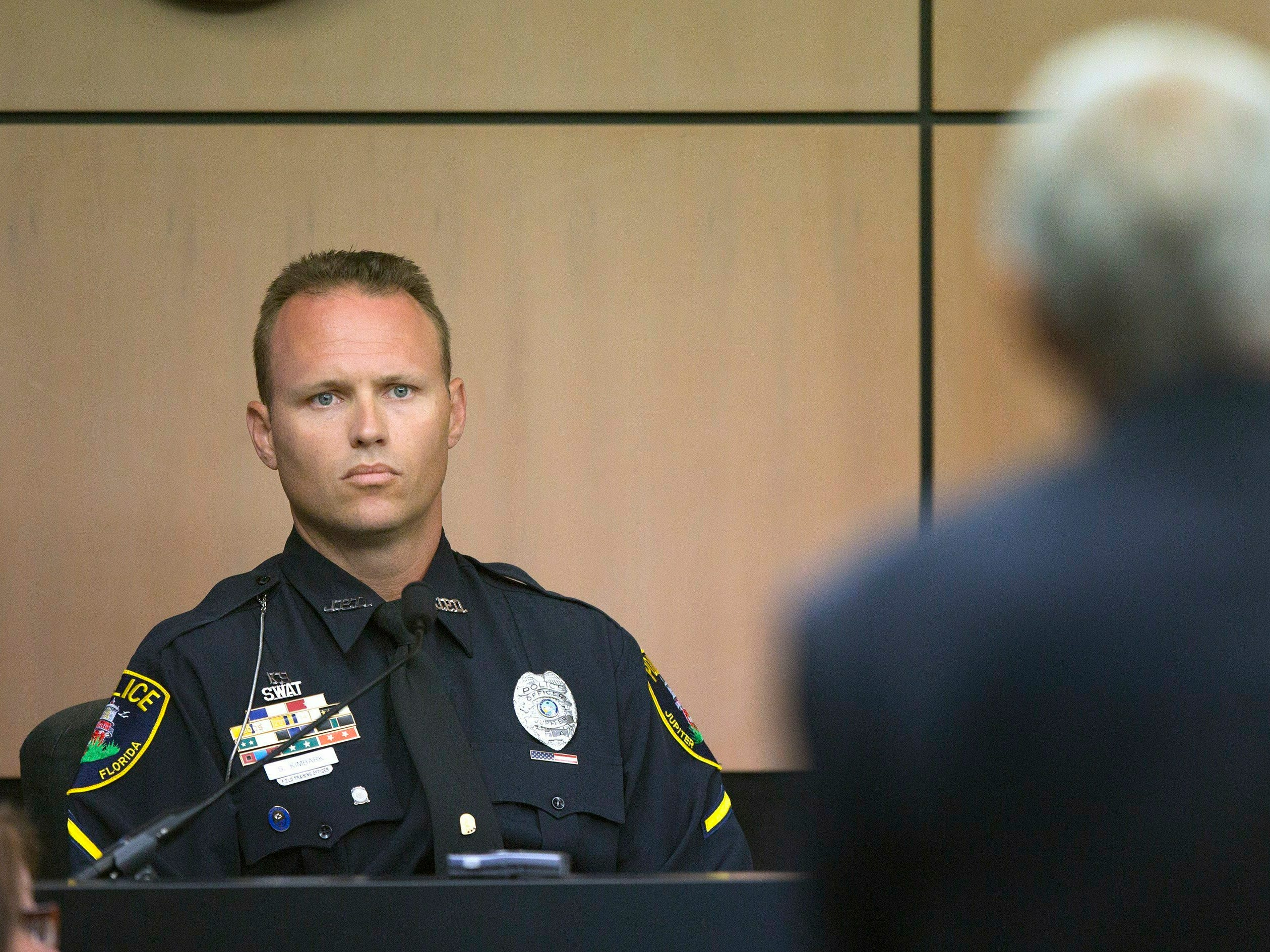 Jupiter police officer Scott Kimbark is questioned as he testifies during a motion hearing in New England Patriots owner Robert Kraft prostitution solicitation case, Wednesday, May 1, 2019, in West Palm Beach. Kimbark stopped the car containing Kraft. Kraft's attorneys argue that undercover surveillance videos allegedly showing their client paying for sex at a Jupiter day spa should be ruled inadmissible and the evidence thrown out.