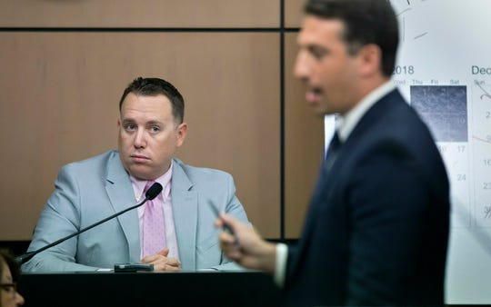 Jupiter Police Detective Andrew Sharp is questioned by Alex Spiro, right, attorney for New England Patriots owner Robert Kraft, during a motion hearing in the Kraft prostitution solicitation case, Wednesday, May 1, 2019, in West Palm Beach. Kraft's attorneys argue that undercover surveillance videos allegedly showing their client paying for sex at a Jupiter day spa should be ruled inadmissible and the evidence thrown out.