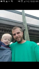 Michael Smith (right) with his son Mason Smith (left). Michael Smith died Tuesday  after running a stop sign and crashing into a house.
