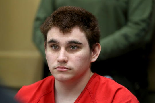 FILE - In this Aug. 15, 2018 file photo, Florida school shooting suspect Nikolas Cruz listens during a status check on his case at the Broward County Courthouse in Fort Lauderdale, Fla. The public defenders representing Cruz who is charged with the Florida high school massacre are set to ask a judge to remove them from the case. The Broward County Public Defender's Office will ask Judge Elizabeth Scherer on Wednesday, May 1, 2019, to order Cruz to hire a private attorney with the $432,000 he may receive from his late mother's life insurance policy. (Amy Beth Bennett/South Florida Sun-Sentinel via AP, Pool, File)