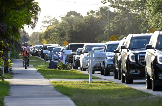 A long line of traffic fills Southwest 34th Street leading to Palm City Elementary School at the west end of the street to drop off their children for the start of the school day Wednesday, May 1, 2019, in Palm City.  Treasure Coast Classical Academy Monday opened it's temporary campus just down the road.