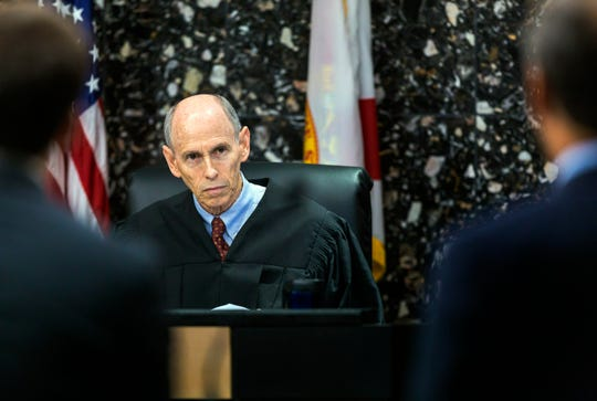 Judge Leonard Hanser listens to Alex Spiro and William Burck, attorneys for Robert Kraft, during a motion hearing in the Kraft case Tuesday, April 30, 2019, in West Palm Beach. The Florida health inspector testified Tuesday that she saw possible evidence of human trafficking at the massage parlor where police say New England Patriots owner Kraft later was accused of paying for sex, leading her to fear for her safety.