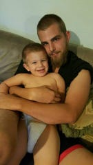 Michael Smith (right) with his son Michael Smith Junior (left.) Michael Smith died on Tuesday after a crash. His sister, Ashley Smith, said he would do anything for his two sons.