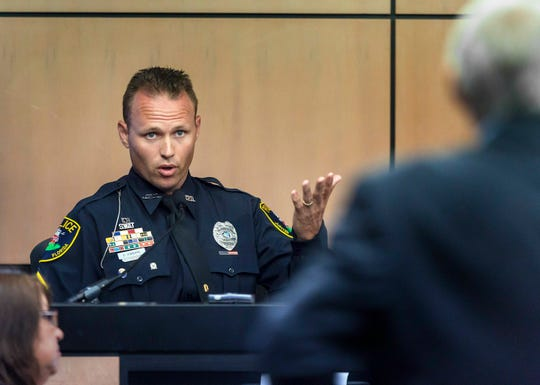 Jupiter police officer Scott Kimbark is questioned as he testifies during a motion hearing in New England Patriots owner Robert Kraft prostitution solicitation case, Wednesday, May 1, 2019, in West Palm Beach, Fla. Kimbark stopped the car containing Kraft. Kraft's attorneys argue that undercover surveillance videos allegedly showing their client paying for sex at a Jupiter day spa should be ruled inadmissible and the evidence thrown out.
