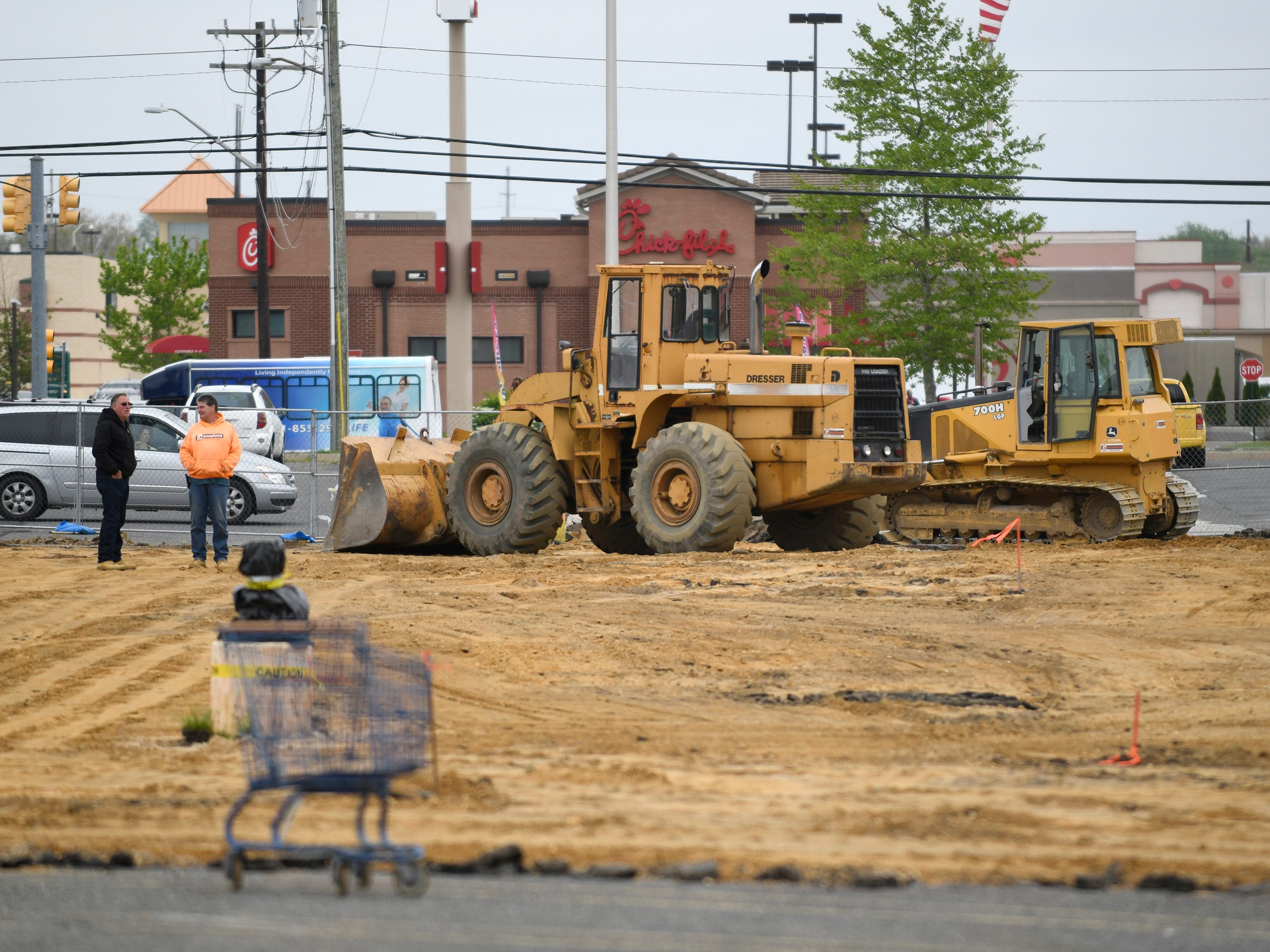 A Sansalone Excavating construction crew worked on removing asphalt in front of Raymour & Flanigan to clear the way for a new ALDI supermarket next to the Olive Garden on South Delsea Drive in Vineland on Wednesday, May 1, 2019.