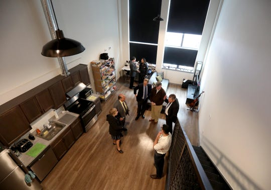 People take a tour of one of the apartments at the Lofts on Main in Peekskill May 1, 2019. A grand opening ceremony was held for the new project, which is a $28 million mixed-use development with 75 loft-style apartments geared toward artists.