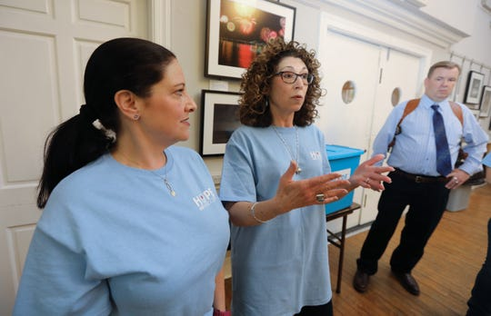 """Cathy Kennedy, left, Caren Schwartz and Piermont Police Chief Michael O'Shea talk about the """"Hope Not Handcuffs"""" program that trains police departments to help people seeking opioid addiction treatment May 1, 2019."""