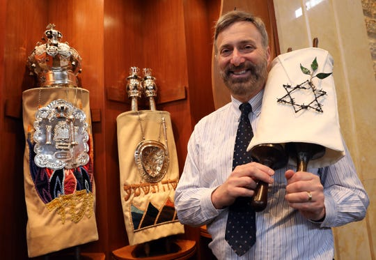 Rabbi Daniel Pernick holds the second Holocaust Torah, which will be part of a memorial, at Beth Am Temple in Pearl River May 1, 2019. Their first one is at left.