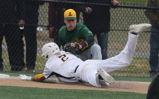 Lucas Feliciano of Walter Panas is tagged out at third base by Zach Cohen after Feliciano tried to tag up in the second inning of a varsity baseball game in Mohegan Lake May 1, 2019. Lakeland defeated Panas 6-0.