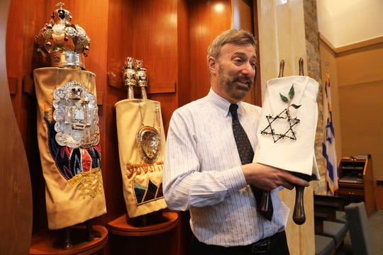 Rabbi Daniel Pernick talks about the second Holocaust Torah, which will be part of a memorial, at Beth Am Temple in Pearl River May 1, 2019. Their first one is at left.